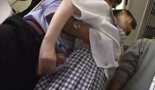 Teen hottie strokes a cock in a bus
